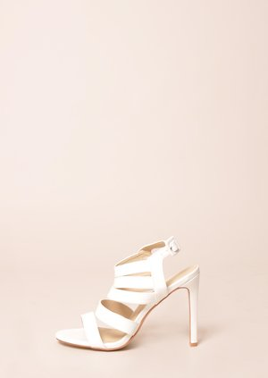 data/2015-/April/Shana white strappy heel side.jpg